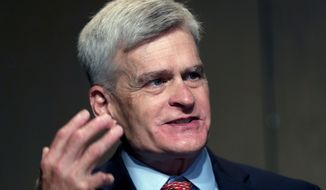 In this July 24, 2020, file photo, Sen. Bill Cassidy, R-La., delivers remarks to media after registering as a candidate to run as an incumbent in Baton Rouge, La. (AP Photo/Gerald Herbert)