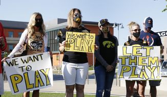 University of Iowa football players parents protest outside Big Ten headquarters in Rosemont, Ill., Friday, Aug. 21, 2020. Parents of Big Ten football players, upset over the process that led to the postponement of the season until spring,  held a protest near the conference's Chicago-area headquarters Friday while an attorney in Nebraska demanded commissioner Kevin Warren turn over material illustrating how the decision was made. (Stacey Wescott/Chicago Tribune via AP)  **FILE**