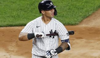 New York Yankees' Gleyber Torres reacts after he struck out looking during the second inning of the team's baseball game against the Atlanta Braves, Wednesday, Aug. 12, 2020, in New York. (AP Photo/Kathy Willens)