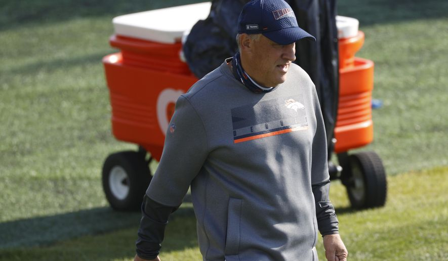 Denver Broncos head coach Vic Fangio watches as players take part in drills during NFL football training camp at the team's headquarters Wednesday, Aug. 19, 2020, in Englewood, Colo. (AP Photo/David Zalubowski)