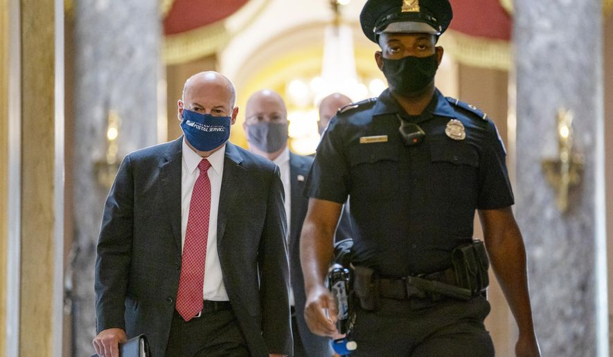 Postmaster General Louis DeJoy, left, is escorted to House Speaker Nancy Pelosi's office on Capitol Hill in Washington, Wednesday, Aug. 5, 2020.  Facing public backlash, DeJoy is set to testify Friday about disruptions in mail delivery. (AP Photo/Carolyn Kaster)