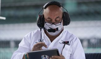 In this photo taken on Sunday, Aug. 16, 2020, Bobby Rahal looks at data during qualifications for the Indianapolis 500 auto race at Indianapolis Motor Speedway, in Indianapolis. (AP Photo/Darron Cummings)
