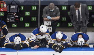 St. Louis Blues' Robert Thomas (18), David Perron (57), Ryan O'Reilly (90) and Brayden Schenn (10) react after losing to the Vancouver Canucks in an NHL Western Conference Stanley Cup playoff series game, in Edmonton, Alberta, Friday, Aug. 21, 2020. (Jason Franson/The Canadian Press via AP)