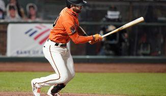 San Francisco Giants' Evan Longoria hits a single against the Arizona Diamondbacks during the fifth inning of a baseball game in San Francisco, Friday, Aug. 21, 2020. (AP Photo/Tony Avelar)