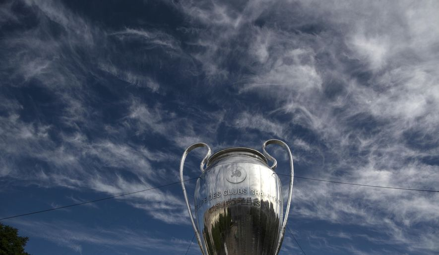 A giant replica of the UEFA Champions League trophy is displayed at the Rossio square downtown Lisbon, Portugal, Friday, Aug. 21, 2020. PSG will play Bayern in the Champions League final on Sunday. (AP Photo/Manu Fernandez)