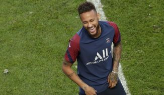 PSG's Neymar talks with head coach Thomas Tuchel during a training session at the Luz stadium in Lisbon, Saturday Aug. 22, 2020. PSG will play Bayern Munich in the Champions League final soccer match on Sunday. (AP Photo/Manu Fernandez, Pool)