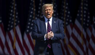 President Donald Trump arrives to speak to a crowd of supporters at Mariotti Building Products in Old Forge, Pa. on Thursday, Aug. 20, 2020. (Christopher Dolan / The Times-Tribune via AP)