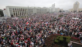 Thousands of people gather for a protest at the Independence square in Minsk, Belarus, Sunday, Aug. 23, 2020. Demonstrators are taking to the streets of the Belarusian capital and other cities, keeping up their push for the resignation of the nation's authoritarian leader. President Alexander Lukashenko has extended his 26-year rule in a vote the opposition saw as rigged. (AP Photo/Dmitri Lovetsky)