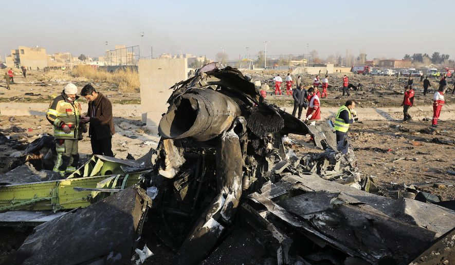 This Jan. 8, 2020, file photo shows debris at the scene where a Ukrainian plane crashed in Shahedshahr southwest of the capital Tehran, Iran. Iran has retrieved some data, including a portion of cockpit conversations, from the Ukrainian jetliner accidentally downed by the Revolutionary Guard forces in January, killing all 176 people on board, an Iranian official said Sunday, Aug. 23, 2020. (AP Photo/Ebrahim Noroozi, File)