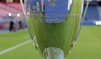 Trophy for the winners of the Champions League final soccer match between Paris Saint-Germain and Bayern Munich is placed on the pitch at the Luz stadium in Lisbon, Portugal, Sunday, Aug. 23, 2020. (Miguel A. Lopes/Pool via AP)