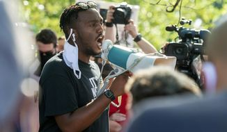 Devon Tre Norman speaks at a vigil and protest, Saturday, Aug. 22, 2020, in Lafayette, La., for 31-year-old Trayford Pellerin, who was shot and killed by Lafayette police officers while armed with a knife the night before. (Scott Clause/The Daily Advertiser via AP)