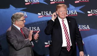 Maximo Alvarez, president of Sunshine Gasoline Distributors, Inc., left, applauds as President Donald Trump listens during a roundtable discussion on tax cuts for Florida small businesses, in Hialeah, Fla. (AP Photo/Lynne Sladky)
