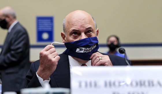 Postmaster General Louis DeJoy removes his face mask as he arrives to testify before a House Oversight and Reform Committee hearing on the Postal Service on Capitol Hill, Monday, Aug. 24, 2020, in Washington. (Tom Brenner/Pool via AP)