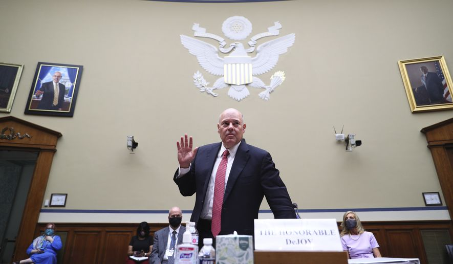 Postmaster General Louis DeJoy is sworn in before testifying before a House Oversight and Reform Committee hearing on the Postal Service on Capitol Hill, Monday, Aug. 24, 2020, in Washington. (Tom Brenner/Pool via AP)