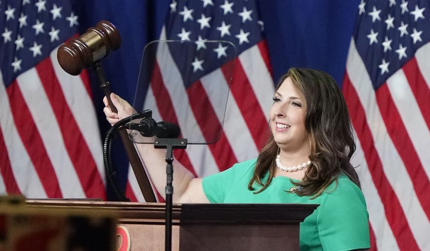 Republican National Committee Chairwoman, Ronna McDaniel, gavels the call-to-order at the opening of the first day of the Republican National Convention Monday, Aug. 24, 2020, in Charlotte, N.C. (AP Photo/Chris Carlson)