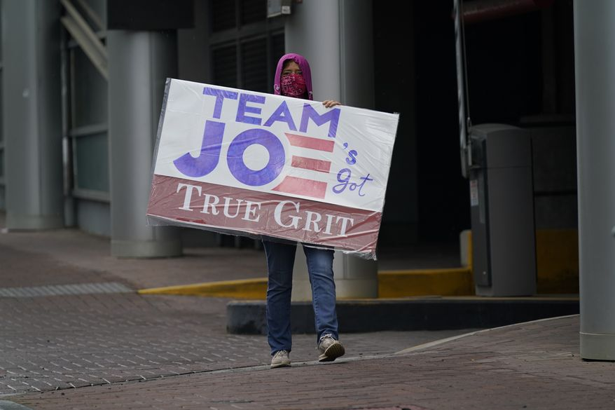 Mosie Boyd, a supporter of Democratic presidential candidate, former Vice President Joe Biden, walks near the venue during the first day of the Republican National Convention on Monday, Aug. 24, 2020, in Charlotte, N.C. (AP Photo/Gerry Broome)