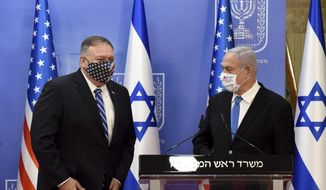 U.S. Secretary of State Mike Pompeo, left, and Israeli Prime Minister Benjamin Netanyahu wear face masks to help prevent the spread of the coronavirus after they make joint statements to the press, in Jerusalem, Monday, Aug. 24, 2020. (Debbie Hill/Pool via AP)