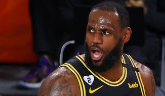 Los Angeles Lakers' LeBron James reacts against during the second quarter of Game 4 of an NBA basketball first-round playoff series against the Portland Trail Blazers, Monday, Aug. 24, 2020, in Lake Buena Vista, Fla. (Kevin C. Cox/Pool Photo via AP)