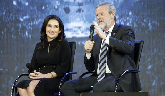 "This Wednesday, Nov. 28, 2018, file photo shows the Rev. Jerry Falwell Jr., right, and his wife during after a town hall at a convocation at Liberty University in Lynchburg, Va. Falwell Jr. says he is seeking help for the ""emotional toll"" from an affair his wife had with a man who he says later threatened his family. (AP Photo/Steve Helber)"