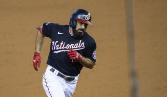 Washington Nationals' Adam Eaton rounds the bases after hitting a two-run home run during the eighth inning of a baseball game against the Miami Marlins in Washington, Monday, Aug. 24, 2020. (AP Photo/Manuel Balce Ceneta)  **FILE**