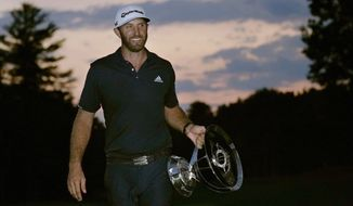 Dustin Johnson carries the trophy after winning the Northern Trust golf tournament at TPC Boston, Sunday, Aug. 23, 2020, in Norton, Mass. (AP Photo/Charles Krupa)  **FILE**