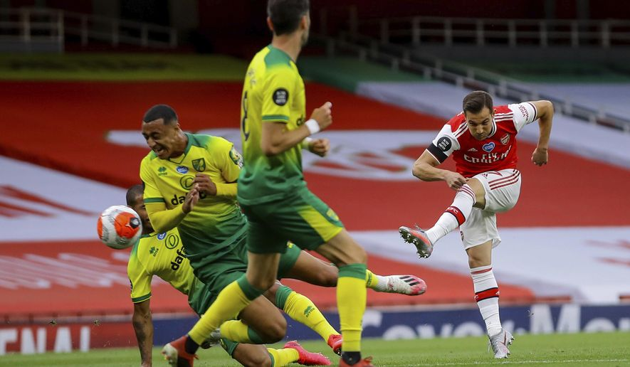 Arsenal's Cedric Soares scores his side fourth goal during the English Premier League soccer match between Arsenal and Norwich City at the Emirates Stadium in London, England, Wednesday, July 1, 2020. (Richard Heathcote/Pool via AP)