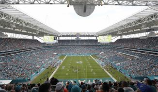 In this Sunday, Sept. 25, 2016 file photo, Hard Rock Stadium is seen during the second half of an NFL football game between the Miami Dolphins and the Cleveland Browns, in Miami Gardens, Fla. The Miami Dolphins NFL football team has decided to allow up to 13,000 socially distancing fans to attend their home opener against the Buffalo Bills on Sept 20, with the approval of state and local political leaders. (AP Photo/Lynne Sladky, File)  **FILE**