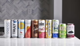 """This January 2020 photo shows a selection of hard seltzer on a counter in New York. The most recent """"it drink"""" is hard seltzer, served on plenty of patios and sidewalk tables during this pandemic summer. Hard seltzer, also known as spiked seltzer or hard sparkling water, contains carbonated water, alcohol and flavoring. (Cheyenne Cohen/Katie Workman via AP)"""
