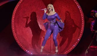"""FILE - Katy Perry performs during the B96 Jingle Bash in Rosemont, Ill., on Dec. 7, 2019. Perry's latest album """"Smile"""" will be released on Friday, Aug. 28. (Photo by Rob Grabowski/Invision/AP, File)"""