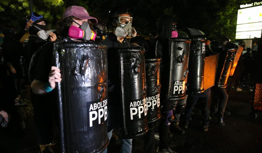 Portland protests continued as a group of several hundred gather outside the Portland Police Bureau: North Precinct on Sunday, Aug. 23, 2020. (Mark Graves/The Oregonian via AP)
