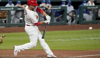 St. Louis Cardinals' Paul DeJong hits a two-run double during the fifth inning of a baseball game against the Kansas City Royals Monday, Aug. 24, 2020, in St. Louis. (AP Photo/Jeff Roberson)