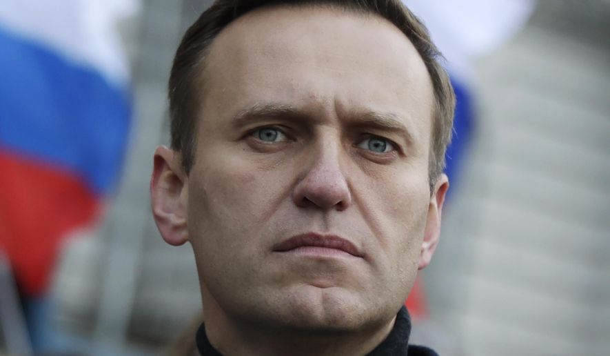 In this file photo taken on Saturday, Feb. 29, 2020, Russian opposition activist Alexei Navalny takes part in a march in memory of opposition leader Boris Nemtsov in Moscow, Russia. The German hospital treating Russian dissident Alexei Navalny says tests indicate that he was poisoned. (AP Photo/Pavel Golovkin, File)