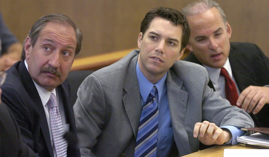Scott Peterson, center, with defense attorneys Mark Geragos, left, and Pat Harris listens to judge Alfred A. Delucchi in a Redwood City, Calif., courtroom, Thursday, July 29, 2004. On Monday, August 24, 2020, the California Supreme Court overturned the 2005 death sentence for Peterson in the slaying of his pregnant wife. The court says prosecutors may try again for the same sentence if they wish in the high-profile case. It upheld his 2004 conviction of murdering Laci Peterson, who was eight months pregnant with their unborn son. (Al Golub/The Modesto Bee,Pool)
