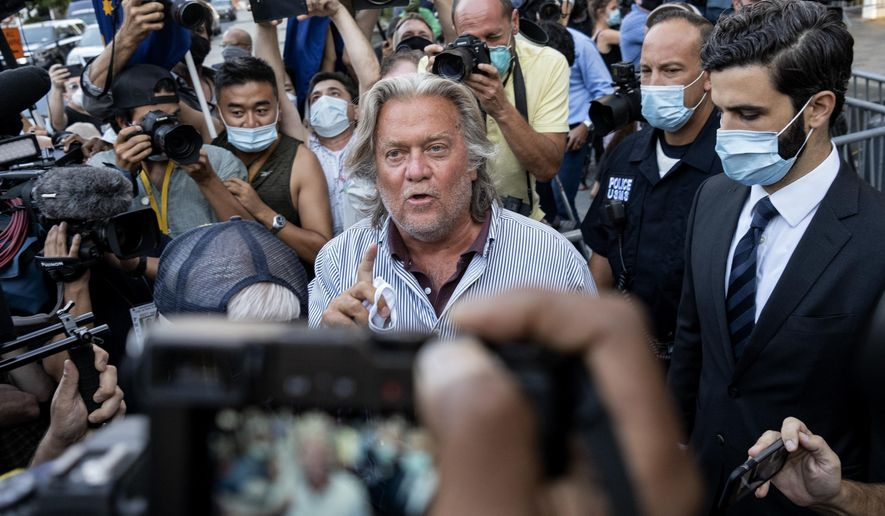 President Donald Trump's former chief strategist Steve Bannon leaves federal court, Thursday, Aug. 20, 2020, after pleading not guilty to charges that he ripped off donors to an online fundraising scheme to build a southern border wall. (AP Photo/Craig Ruttle)