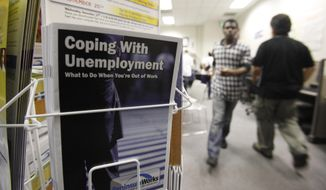 In this July 20, 2010, file photo, people arrive to seek employment opportunities at a JobTrain office in Menlo Park, Calif. (AP Photo/Paul Sakuma, File)