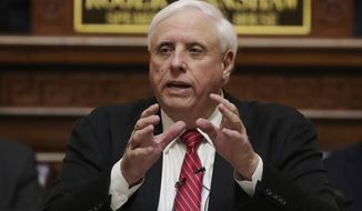 In this file photo, West Virginia Gov. Jim Justice delivers his annual State of the State address in the House Chambers at the state capitol in Charleston, W.Va., Wednesday,  Jan. 8, 2020. Nursing home visits are being allowed again in West Virginia as the state focuses on coronavirus outbreaks in the general populations of individual counties without clamping down on areas without them. Justice warned Monday, Aug. 24, 2020, that the visits could end quickly in some places if further outbreaks occur within nursing homes themselves. (AP Photo/Chris Jackson, File)  **FILE**