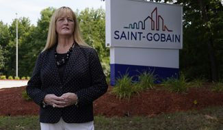 In this Friday, Aug. 14, 2020, photo New Hampshire Rep. Nancy Murphy, D-Merrimack, poses for a photo outside the Saint-Gobain plastics factory in Merrimack, N.H. (AP Photo/Charles Krupa)