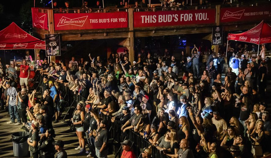 FILE - In this Friday, Aug. 14, 2020, file photo fans attend a performance by Saul at the Iron Horse Saloon during the 80th annual Sturgis Motorcycle Rally, in Sturgis, S.D. South Dakota health officials warned Thursday, Aug. 20, that a number of people who attended the 10-day Sturgis Motorcycle Rally this month, including some who came from out of state, have come down with COVID-19. (Amy Harris/Invision/AP, File)