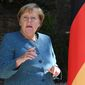 German Chancellor Angela Merkel reacts as she arrives for a meet with French President Emmanuel Macron at the Fort de Bregancon, southern France, Thursday, Aug. 20, 2020. The leaders of Germany and France are meeting Thursday at a Mediterranean retreat for talks on how to resuscitate Europe's economy without causing a new virus crisis, and on a growing number of global hot spots. (Christophe Simon/Pool Photo via AP)