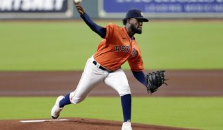 Houston Astros starting pitcher Cristian Javier throws against the Los Angeles Angels during the first inning of the first game of a doubleheader baseball game Tuesday, Aug. 25, 2020, in Houston. (AP Photo/Michael Wyke)