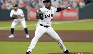 Houston Astros starting pitcher Framber Valdez (59) throws against the Los Angeles Angels during the first inning of a baseball game Monday, Aug. 24, 2020, in Houston. (AP Photo/Michael Wyke)