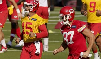 Kansas City Chiefs quarterback Patrick Mahomes (15) and tight end Travis Kelce (87) run during an NFL football training camp Saturday, Aug. 22, 2020, at Arrowhead Stadium in Kansas City, Mo. The Chiefs opened the stadium to 2,000 season ticket holders to watch practice as the team plans to open the regular season with a reduced capacity of approximately 22 percent or normal. (AP Photo/Charlie Riedel)