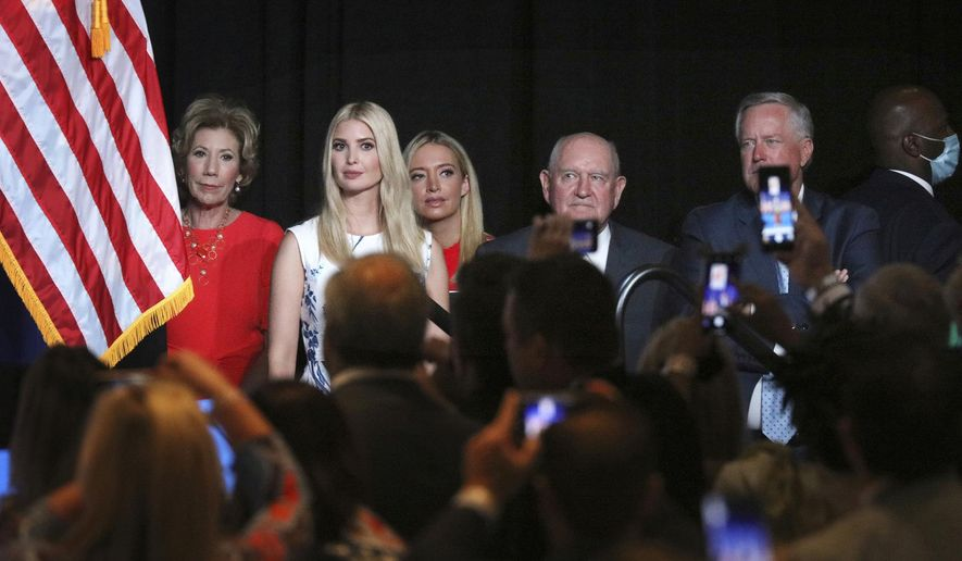 Ivanka Trump, the daughter and senior adviser to the President, second from left, and White House Chief of Staff Mark Meadows, right, and members of the White House staff, listen as President Trump speaks during the first day of the Republican National Convention Monday, Aug. 24, 2020, in Charlotte, N.C. (Travis Dove/The New York Times via AP, Pool)