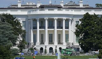 FILE - In this Aug. 18, 2020, file photo workers construct staging on the South Lawn of the White House in Washington. Donald Trump is expected to speak to the Republican National Committee convention from the South Lawn of the White House. (AP Photo/Patrick Semansky, File)