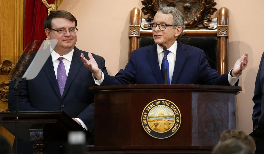 FILE - In this March 5, 2019 file photo, Ohio Governor Mike DeWine, center, speaks as Ohio Senate President Larry Obhof, left, listens during the Ohio State of the State address at the Ohio Statehouse in Columbus, Ohio. Rep. John Becker from Cincinnati, said in a release Monday, Aug. 24, 2020, that he has drafted 10 articles of impeachment against fellow Republican DeWine over his handling of the state's response to the coronavirus pandemic. (AP Photo/Paul Vernon/File)