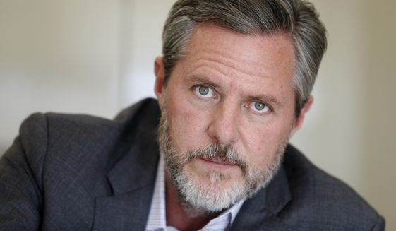 In this Nov. 16, 2016 file photo, Liberty University President Jerry Falwell Jr., pauses during an interview in his office at the school in Lynchburg, Va. (AP Photo/Steve Helber, File)  **FILE**