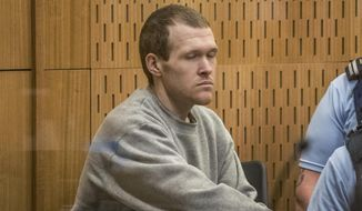 Australian Brenton Harrison Tarrant, 29, sits in the dock on day three at the Christchurch High Court for sentencing after pleading guilty to 51 counts of murder, 40 counts of attempted murder and one count of terrorism in Christchurch, New Zealand, Wednesday, Aug. 26, 2020. More than 60 survivors and family members will confront the New Zealand mosque gunman this week when he appears in court to be sentenced for his crimes in the worst atrocity in the nation's modern history. (John Kirk-Anderson/Pool Photo via AP)