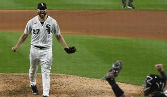 Chicago White Sox starting pitcher Lucas Giolito (27) reacts with catcher James McCann after closing out a no-hitter in a baseball game against the Pittsburgh Pirates, Tuesday, Aug. 25, 2020, in Chicago. The White Sox won 4-0. (AP Photo/Matt Marton)
