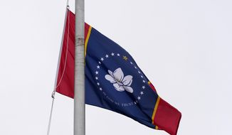 One of five final designs for the new Mississippi state flag flutters in the breeze, outside the Old Capitol Museum in Jackson, Miss., Aug. 25, 2020, in Jackson, Miss. In late June, Mississippi legislators voted to retire the last state flag to include the Confederate battle emblem, which is broadly condemned as racist. All five were flown outside the museum for viewing. The Mississippi State Flag Commission narrowed their choices to two flags, of which this is one. (AP Photo/Rogelio V. Solis)