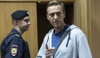 In this Monday, Aug. 27, 2018, file photo, Russian opposition leader Alexei Navalny gestures while speaking in a courtroom in Moscow, Russia. (AP Photo/Pavel Golovkin, File)